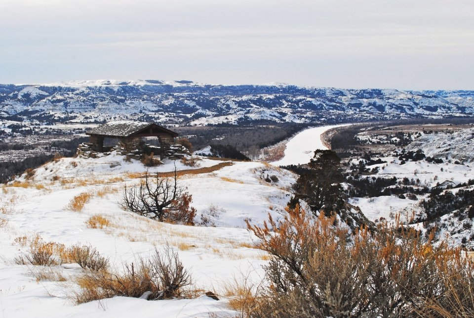 A snow-covered landscape at the river bend overlook at Theodore Roosevelt National Park