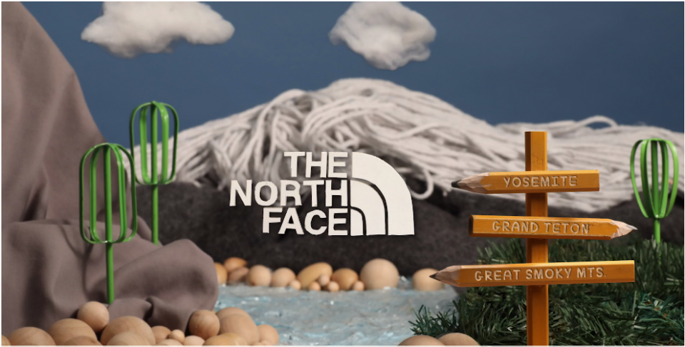The North Face logo over an illustrated park scene