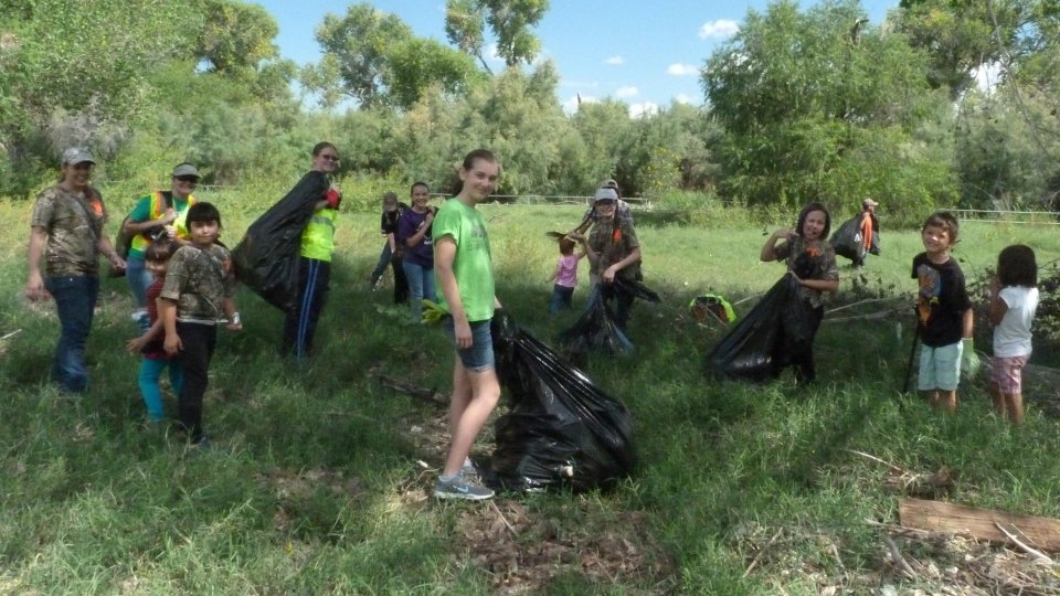 Volunteers cleaning up the trail at Tumacacori National Historical Park