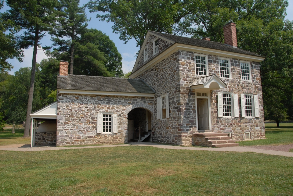 A sidewalk leads up to a three-story stone cottage that served as Washington's headquarters at Valley Forge.