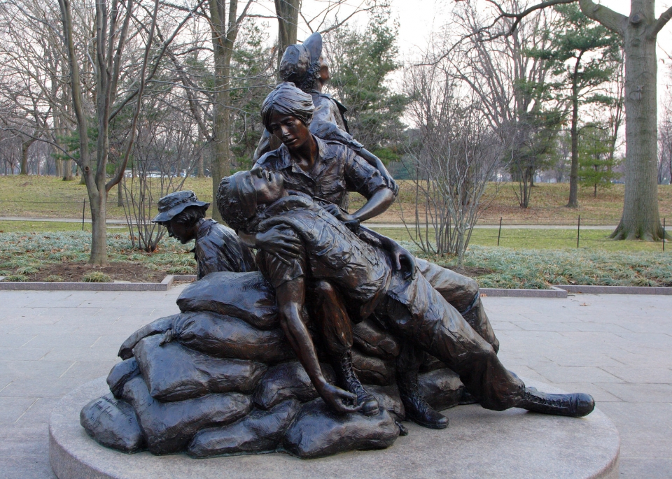 A statue of a woman helping a wounded soldier.