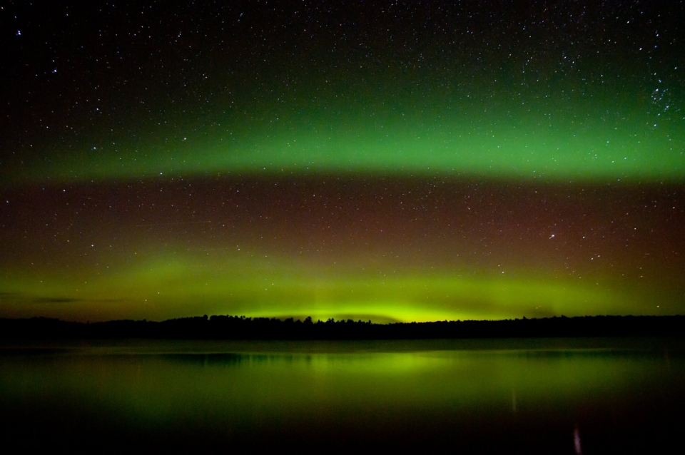 Green and red and yellow aurora borealis northern lights at Voyageurs National Park