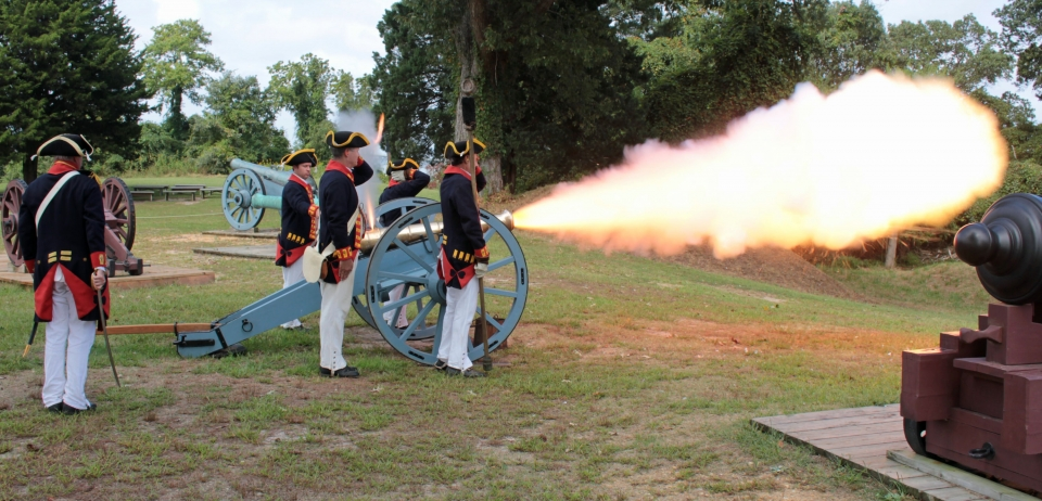 Royal artillery firing during a living history reenactment at Colonial National Historical Park along the Washington-Rochambeau Revolutionary Route National Historic Trail