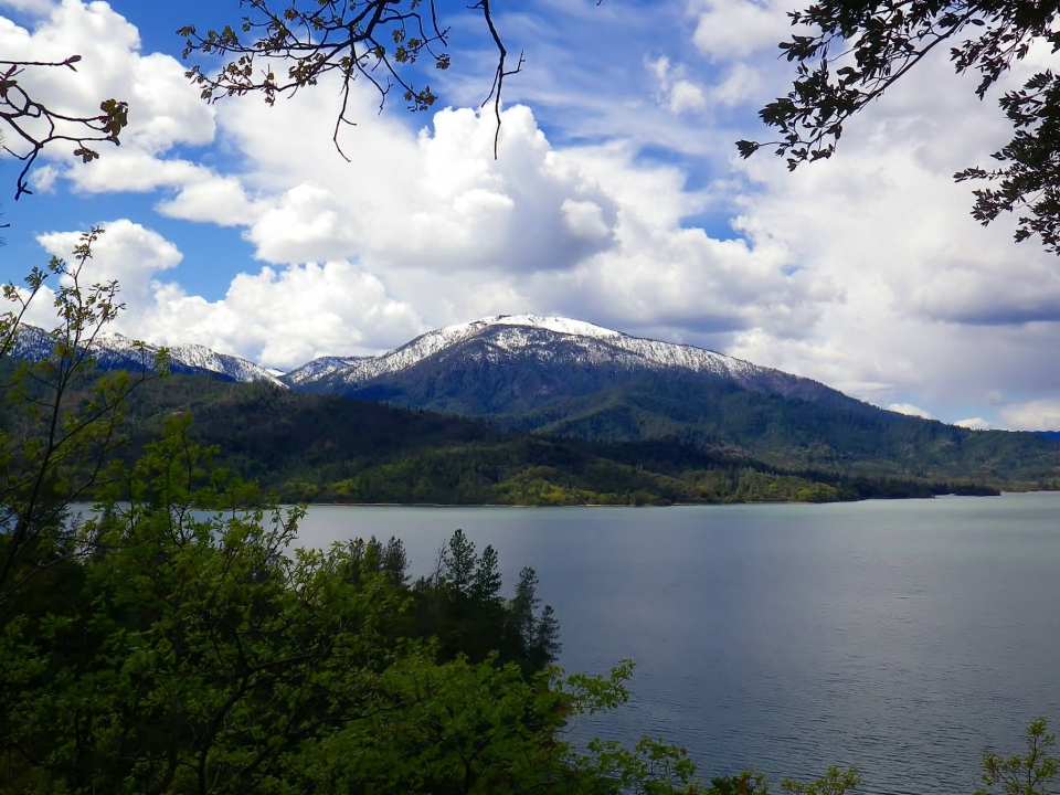 View of lake with snow-capped mountain in the background at Whiskeytown National Recreation Area