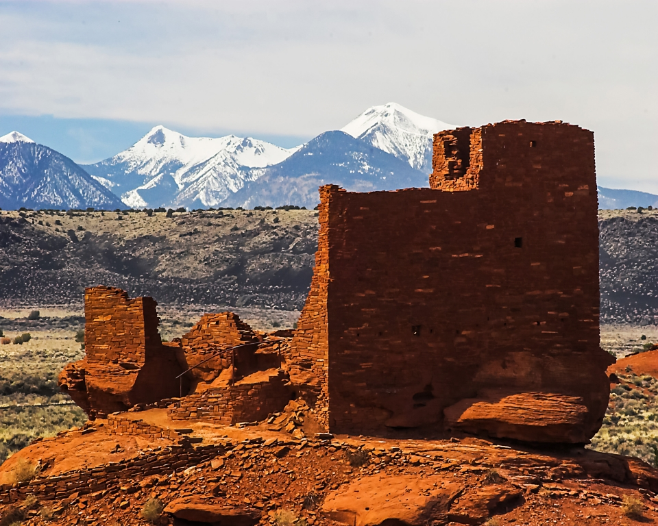 Pueblo ruins of Wupatki National Monument and with snow-capped mountains in the background