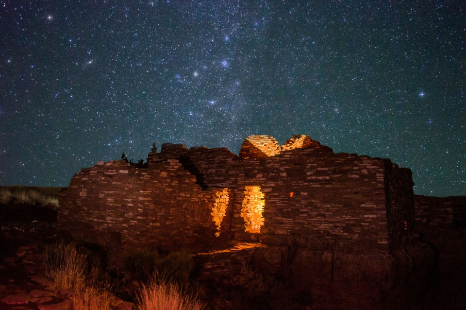 The night sky and the Milky Way behind Lomaki Pueblo in Wupatki National Monument