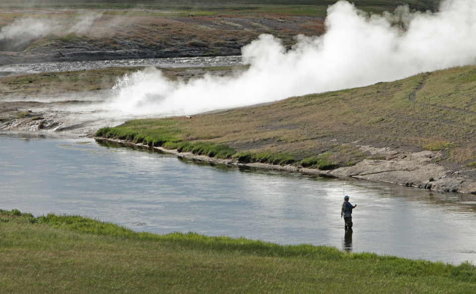 Park visitor fishing in the Firehole River