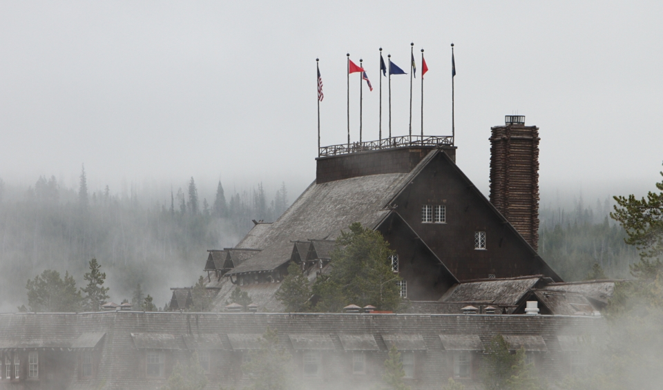 Old Faithfull Inn enshrowded in fog at Yellowstone National Park