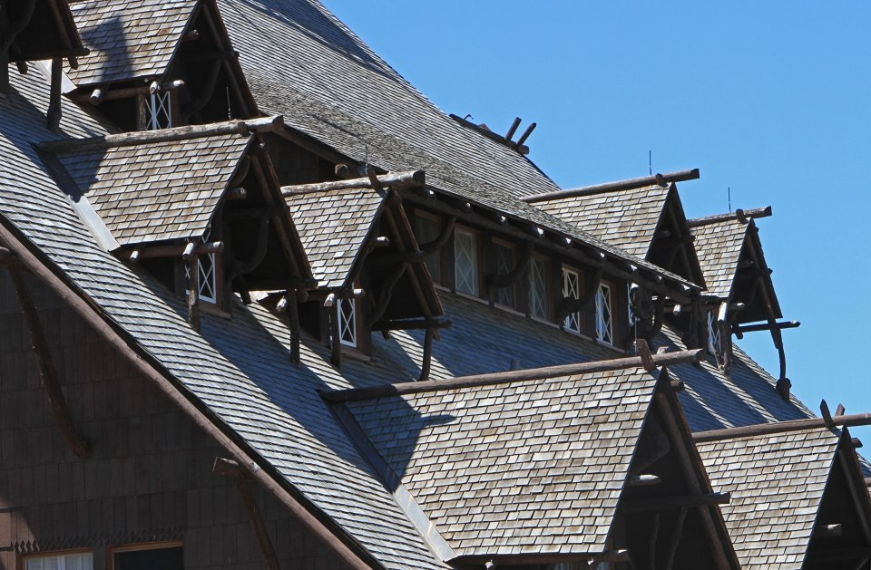 Close-up of the shingled roof and windows of Old Faithful Inn at Yellowstone National Park