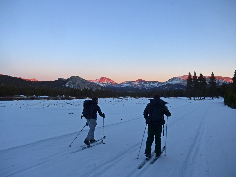 Two cross-country skiers near sunset at Yosemite National Park