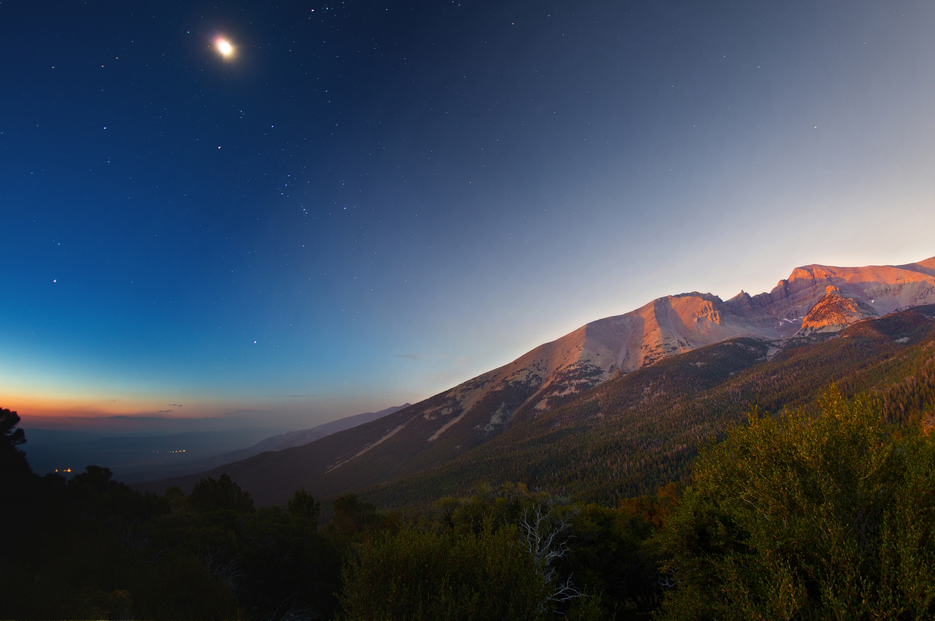 Combination of starlight to dawn on Wheeler Peak