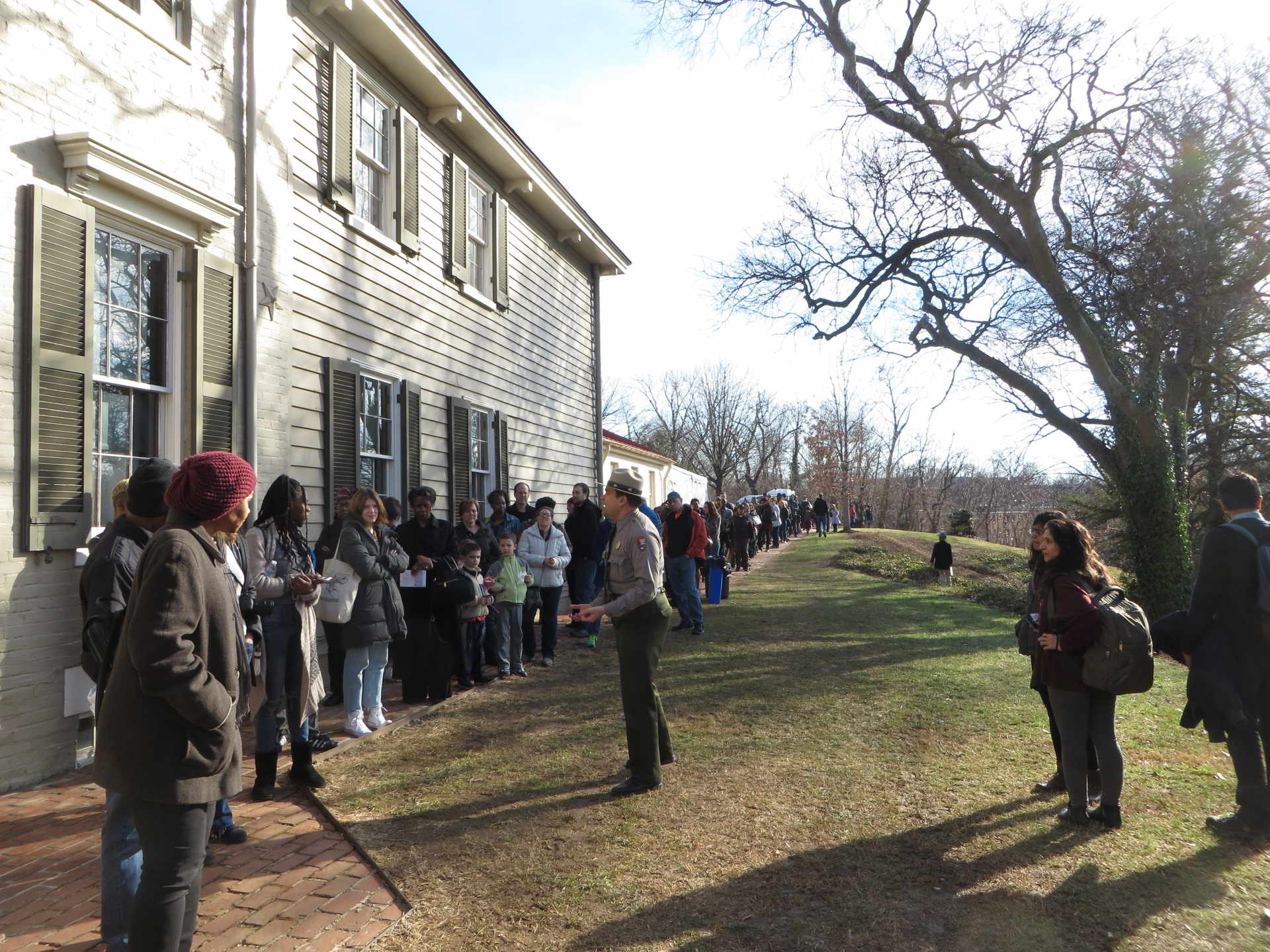 A National Park Service ranger describes Frederick Douglass to those waiting in line to see his home on the 200th anniversary of Douglass's birth