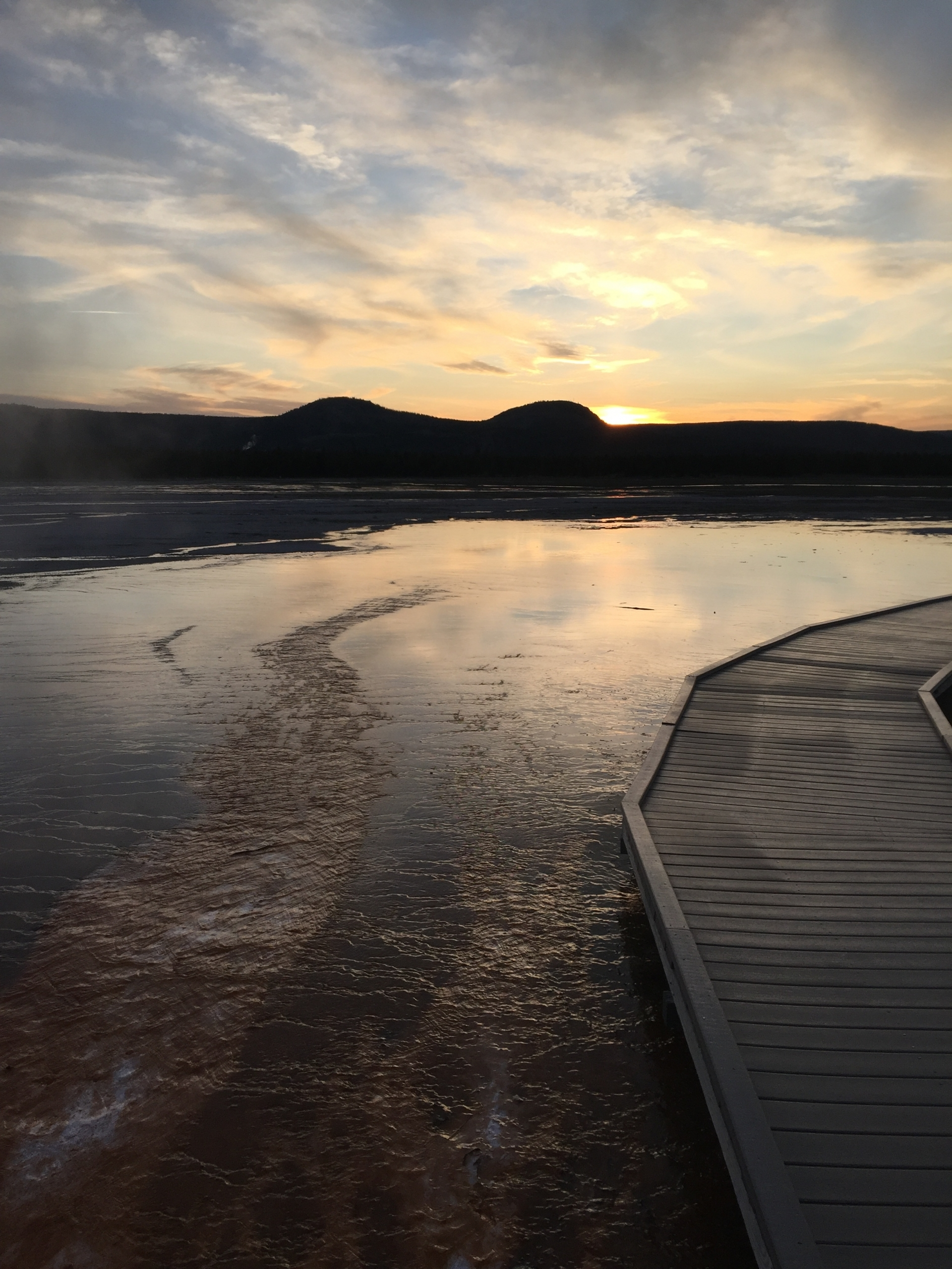 Summer sunset along the boardwalk over Grand Prismatic in Yellowstone National Park