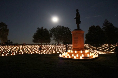 National cemetery illuminated with candles at Fredericksburg and Spotsylvania National Military Park