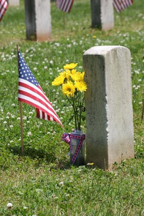Yellow flowers places at grave in Stones River National Battlefield