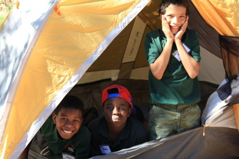 Three students in tent