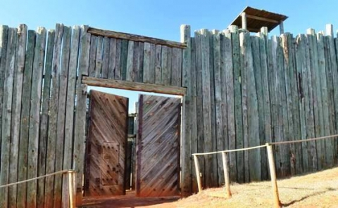 Photo of wooden fence structure with gate at Andersonville National Park