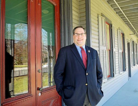 Friends of James A. Garfield National Historic Site Executive Director Andrew Mizsak standing on front porch