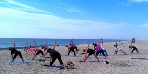 Visitors doing Yoga on beach at Assateague Island