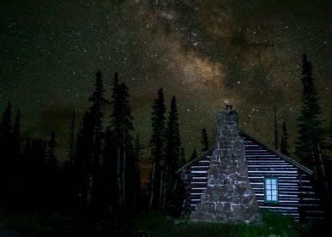 Log cabin under the stars at Cedar Breaks National Monument