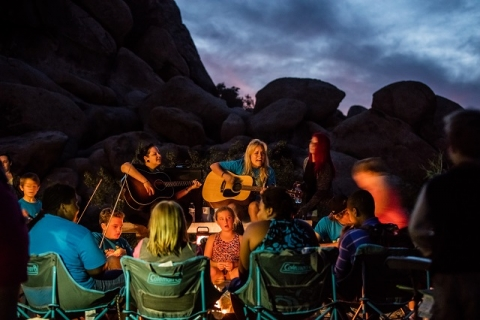 Campout at Joshua Tree National Park with campfire and guitars
