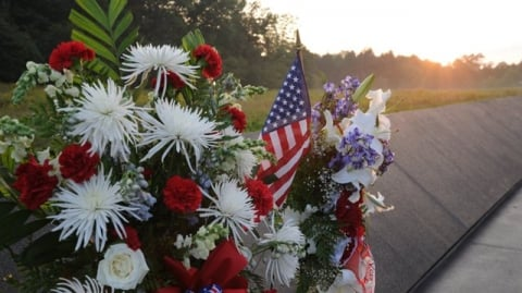 Bouquet of flowers and American flag placed at the Flight 93 National Memorial