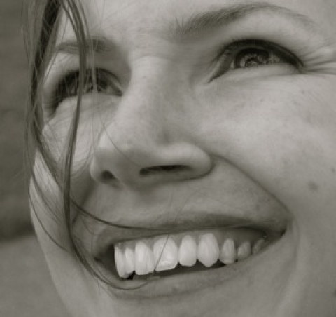 Black and white photo of smiling author, Emily Brisse is a Minnesota writer, photographer, traveler, and trailwalker. (And a high school English teacher, too) Find more of her curious musings at Landing on Cloudy Water.