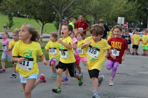 Multiple young children running in the Essex YMCA Race