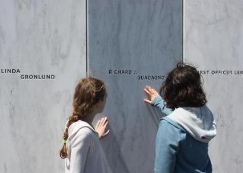 Visitors to the Flight 93 National Memorial touch wall of memorial