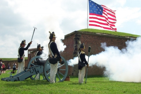 Historic interpreters blowing cannon at Fort McHenry