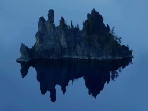 Jagged rock formations on island in Crater Lake