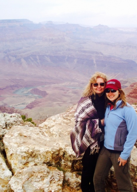 Blog writer, Liz, and her mom posing in front of the scenic Grand Canyon view