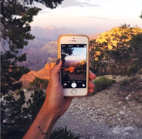 Visitor taking picture of Grand Canyon with iPhone