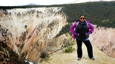Melanie Mendez-Gonzales overlooking the Grand Canyon of the Yellowstone at Yellowstone National Park.