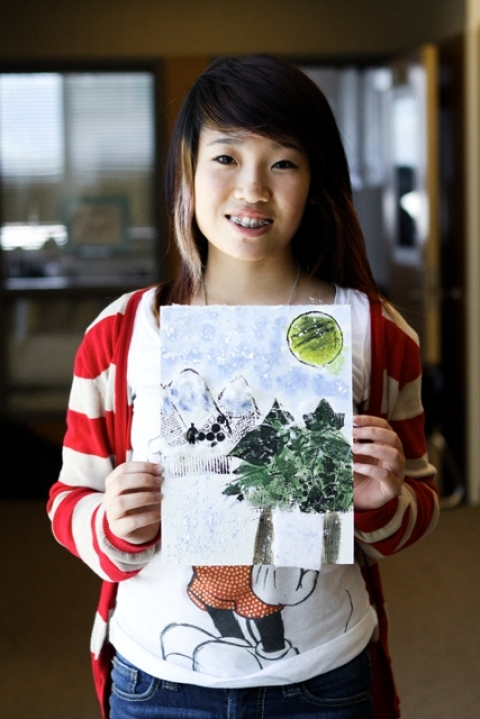 Student holding her work of art