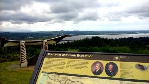 Lewis and Clark National Historic Trail with a park sign in front of a cloudy, gray sky