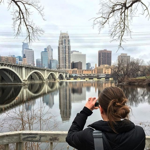Woman taking a photo of the Mississippi River in Minnesota