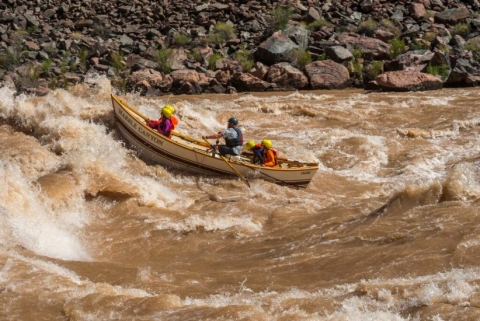 Small boat with people in rapids