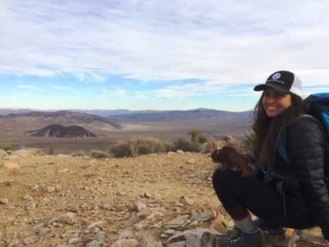 Michelle Pinon sitting on the ground at Joshua Tree National Park