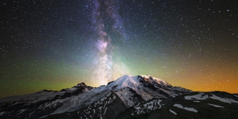 Mount Rainier under starry night sky
