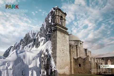 "Graphic art blending both national parks, Denali and the San Antonio Missions together; Mountains and Mission building from left to right. Text: ""PARK: Some parks offer breathtaking views. Others will change your perspective. National Park Service.\"""
