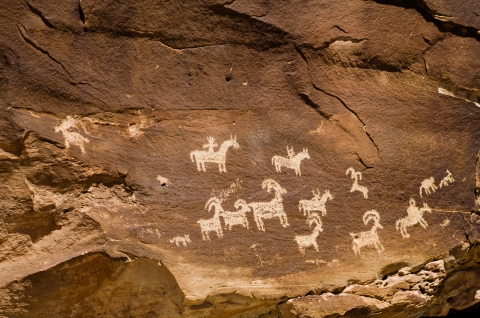 Petroglyphs carved into the sandstone at Arches National Park