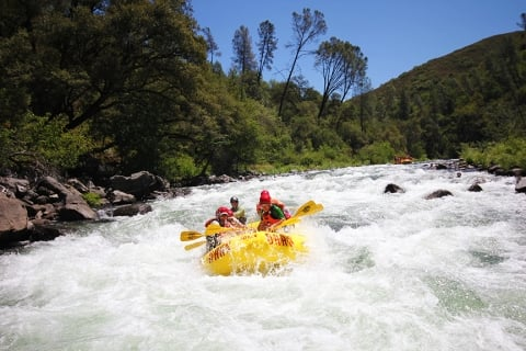 Whitewater rafting down Tuolumne River at Yosemite National Park
