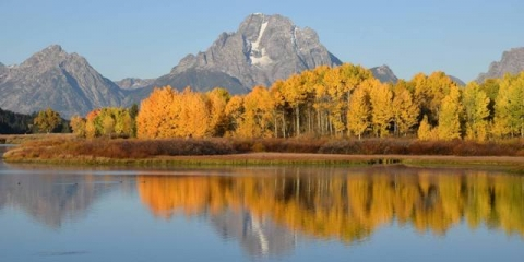 Image of Teton National Park with water, one of ranger Veronica's favorite parks.