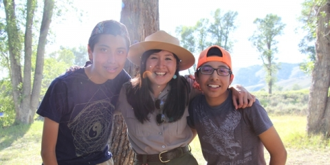 Image of park ranger Veronica Verdin with youth from the Pura Vida program