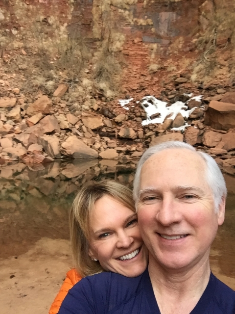Two park visitors take a selfie in Zion National Park