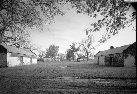 Black and white image of the slave quarters at Magnolia Plantation at Cane River Creole National Historic Park