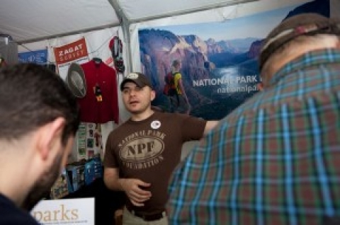 NPF employee speaking at event booth in Central Park