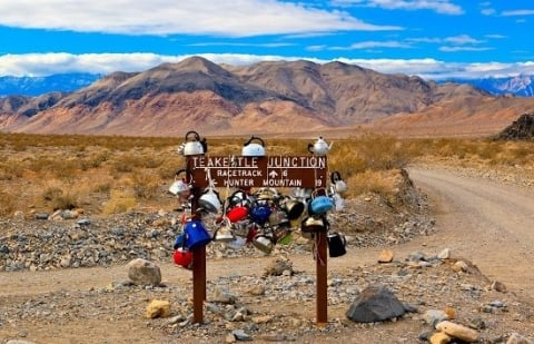 Tea kettles hanging from Death Valley sign