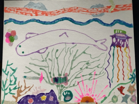 A child's drawing of an underwater scene